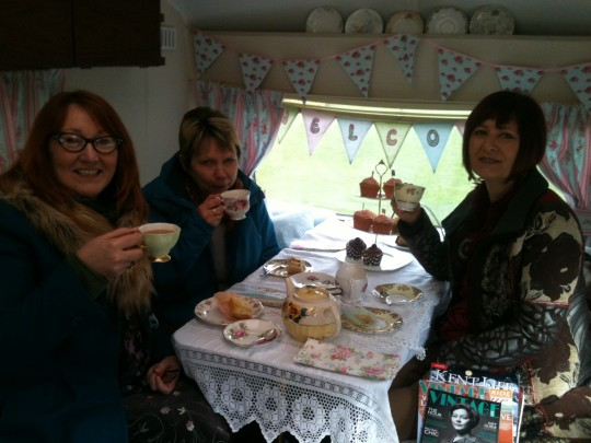 Friends find a warm and cosy welcome and a hot cuppa in Bessie in between shopping at the Quex Vintage Fair