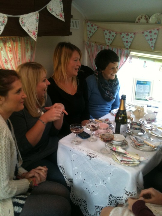 Lovely friends celebrate with bubbles and cake
